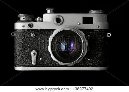 Front view of retro camera isolated on black
