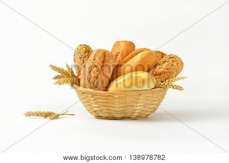 basket of various bread rolls and buns