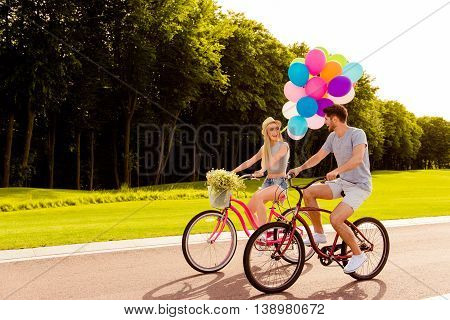 Young Family Having Weekend With Ballons  On Bicycles Ride