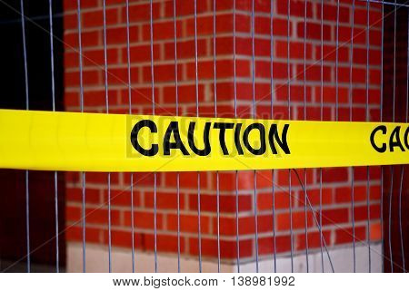 close up on caution warning strip in front of building