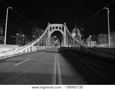 Black and white on bridge leading to downtown Pittsburgh.