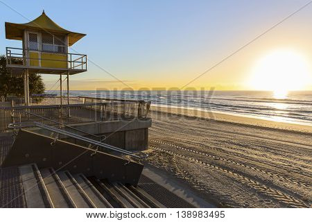 Gold Coast Surfers Paradise beach and surveillance tower at sunrise