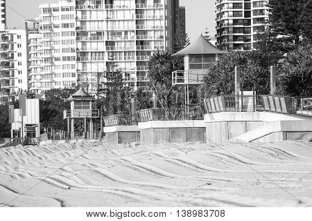 Gold Coast Surfers Paradise beach and surveillance towers at sunrise closeup. Black and White