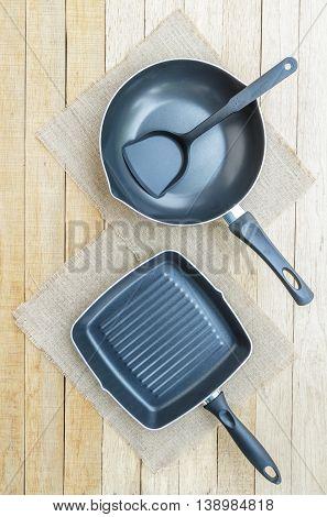 Teflon Pan On Wood Table