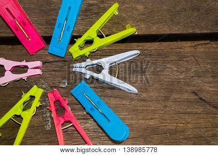 Colorful clothes peg, clothespin on wood background use for dry the clothes under the sun