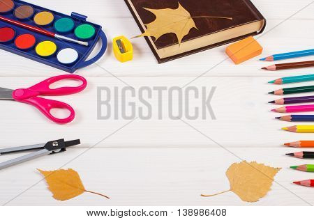 Frame Of School Accessories, Book And Autumnal Leaves On Boards, Back To School