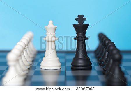 Chess game and blue background. Conceptual scene.