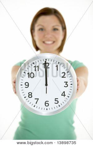 Woman Holding Clock Showing 12 O'Clock