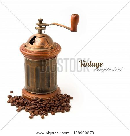 Vintage coffee grinder and coffee beans on white background