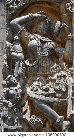 Shilabalike Darpana Sundari - a dancer with mirror in Hoysaleshwara temple at Halebidu Hassan district Karnataka state India Asia