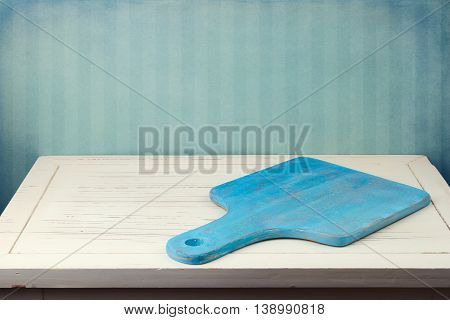 Background with cutting board on wooden vintage table