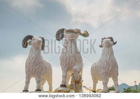 REPULSE BAY HONG KONG - MAY 23: The statues of three celestial rams with sunlight comes through clouds like the God blesses the earth in Kwun Yam temple on May 23 2016 in Repulse Bay Hong Kong.