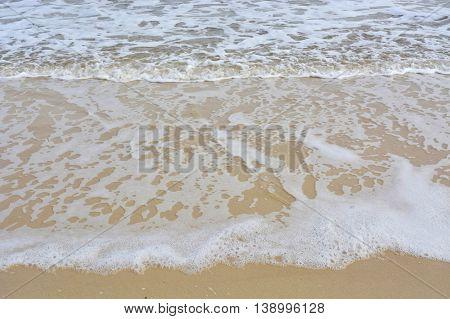 Wave Ripples On Sandy Beach.