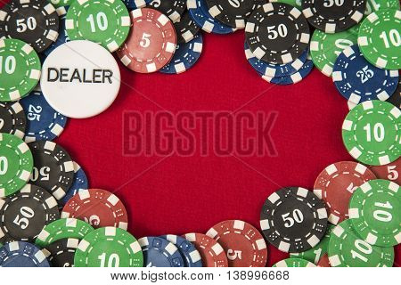 Gambling chips frame around the red card table background