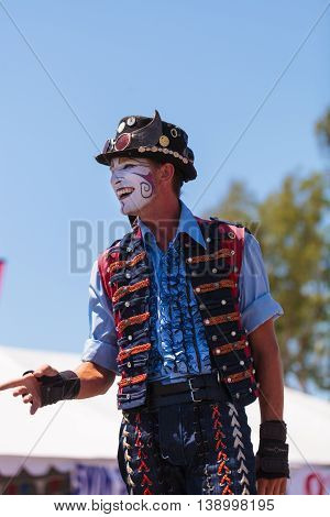 Costa Mesa, CA - July 16, 2016: Performer Benjamin Gadbois with the Dragon Knights steampunk stilt walkers at the Orange County Fair in Costa Mesa, CA on July 16, 2016. Editorial use only.