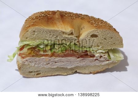 Bagel sandwich with turkey breast, lettuce and tomato