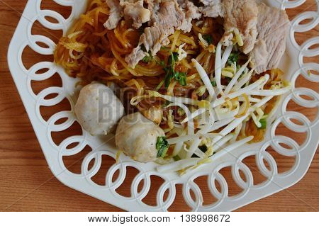 rice noodle filling boiled pork and bean sprout on dish