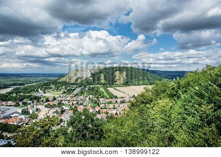 Braunsberg hill and Hainburg an der Donau Austria. Travel destination. Cloudy sky and greenery. Beautiful place.