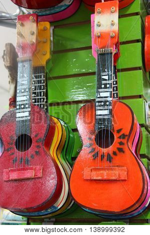 Two colorful guitars