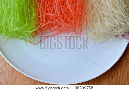 dried colorful Thai rice noodle on white plate