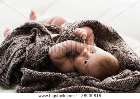 Portrait of a cute smiling infant baby