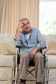 image of disabled person  - Senior man in his wheelchair at home - JPG