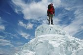 foto of mountain-climber  - Leader on the snow peak - JPG