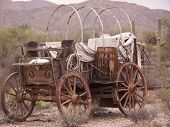 picture of stagecoach  - Broken down stagecoach in a rugged southwest setting