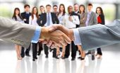 foto of handshake  - handshake isolated on business background - JPG