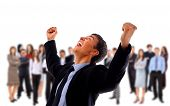 pic of overjoyed  - One very happy energetic businessman with his arms raised - JPG