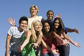stock photo of ethnic group  - Group of six friends having fun outside - JPG