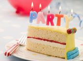 stock photo of sponge-cake  - Party Candles on a Slice of Birthday Cake - JPG