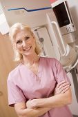 image of mammogram  - Portrait Of A Nurse In Front Of A Mammogram Machine - JPG