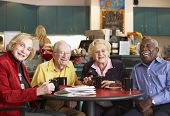 picture of senior adult  - Senior adults having morning tea together - JPG