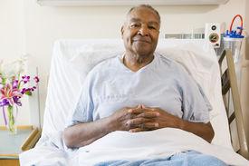 image of hospital patient  - Senior Man Sitting In Hospital Bed - JPG