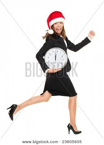 Christmas busy concept. business woman running late busy from work for holidays. Full body portrait of asian caucasian businesswoman wearing santa hat running with clock. Isolated on white background.