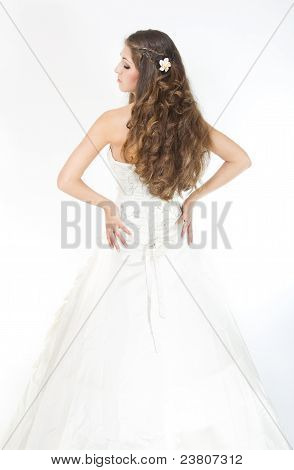 Long Curly Hair. Bride With Hairstyle In Wedding Dress. Back View. Over White