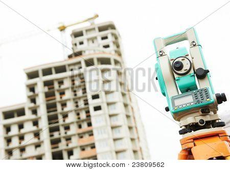 Surveyor equipment tacheometer outdoors at construction site