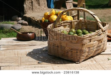 Citrus fruit on rough hewn outdoor wooden table