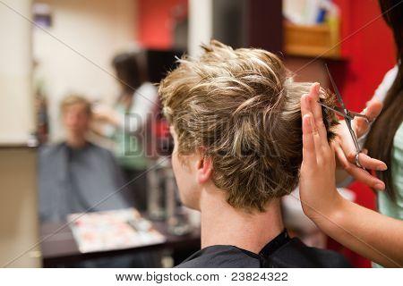 Blond-haired Man Having A Haircut