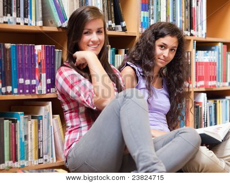 Female Students Holding A Book
