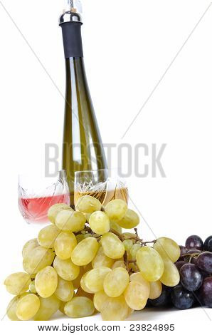 Bottle of wine with aperitive glasses of wine and grapes isolated in white