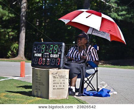 Scorekeeper At Football Game