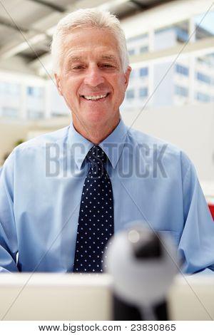 Senior businessman using skype