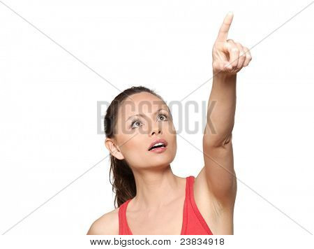 Portrait of cute expressive surprised woman pointing up in studio isolated on white background