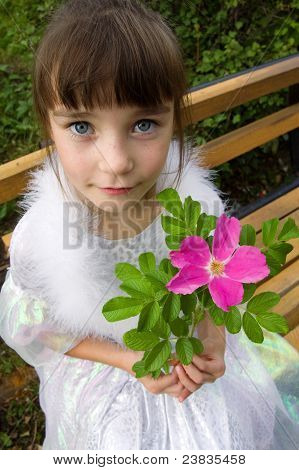 Little Girl Holding Pink Flower