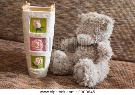 Vase And Toy Bear