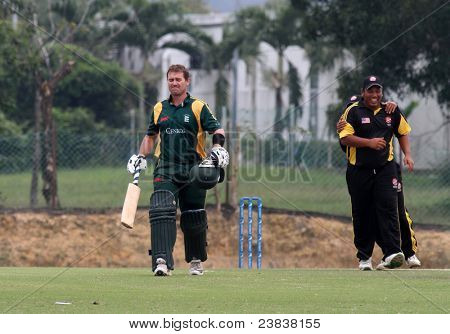 PUCHONG, MALAYSIA - SEPT 24: Guernsey loses another wicket in Adam Martel's dismissal, at the Pepsi ICC World Cricket League Div 6 finals vs Malaysia on Sept 24, 2011 in Kinrara Oval Puchong, Malaysia