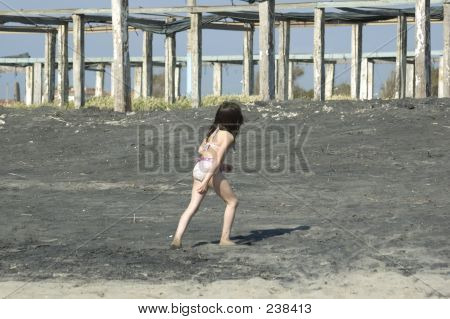 Picture or Photo of Young girl walking on the beach ** Note: Slight blurriness, best at smaller sizes