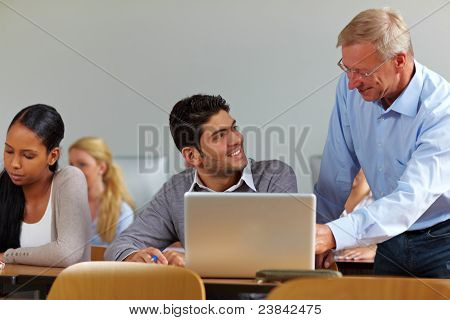 Lecturer Talking To Student